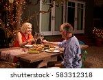 mature couple enjoying outdoor... | Shutterstock . vector #583312318