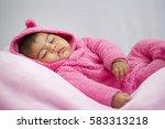 baby girl sleeping on the pink... | Shutterstock . vector #583313218