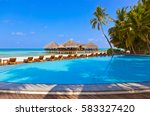pool and cafe on maldives beach ... | Shutterstock . vector #583327420
