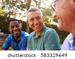 mature male friends socializing ... | Shutterstock . vector #583329649