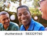 mature male friends socializing ... | Shutterstock . vector #583329760