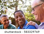 mature male friends socializing ... | Shutterstock . vector #583329769