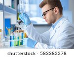 side view of chemist making...   Shutterstock . vector #583382278