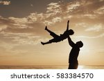 father and son playing on the... | Shutterstock . vector #583384570
