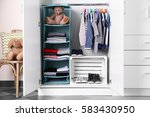 wardrobe with kid clothes | Shutterstock . vector #583430950