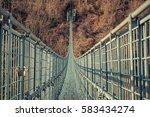suspended bridge | Shutterstock . vector #583434274