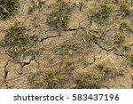 cracking ground | Shutterstock . vector #583437196