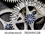 Small photo of Macro photo of tooth wheel mechanism with JOINT EFFORT concept letters