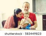 family watching a cartoon on a...   Shutterstock . vector #583449823