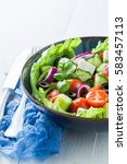 healthy greek salad with cherry ... | Shutterstock . vector #583457113