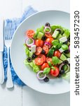 Small photo of Classical Greek salad with cherry tomatoes, lettuce and onion