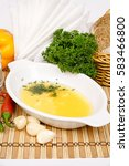 Small photo of Aioli sauce of Provence in white saucers decorated with parsley and fennel on a background of vegetables and cutlery
