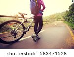 young woman riding mountain... | Shutterstock . vector #583471528