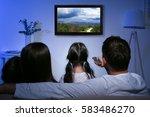 family watching television at