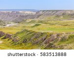 dry arid desert slopes covered... | Shutterstock . vector #583513888