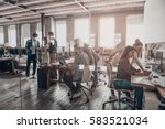 busy working day in office.... | Shutterstock . vector #583521034