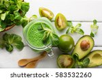 green spinach smoothie with... | Shutterstock . vector #583532260