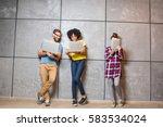 multi ethnic coworkers dressed... | Shutterstock . vector #583534024