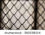blurred metal wire net on... | Shutterstock . vector #583538314