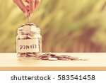 hand putting coins in glass jar ... | Shutterstock . vector #583541458