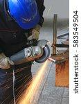 worker grinding a metal part... | Shutterstock . vector #583549504