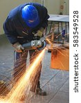 worker grinding a metal part... | Shutterstock . vector #583549528