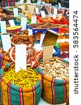 Small photo of The spice stall offers ginger root, cinnamon, pepper and many other spices, Turkish Bazaar of Acre, Israel.