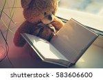 teddy bear reading a book | Shutterstock . vector #583606600