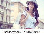 fashionably dressed woman on... | Shutterstock . vector #583626040