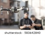 young guys are flying a drone... | Shutterstock . vector #583642840