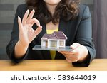 businesswoman showing okay... | Shutterstock . vector #583644019