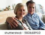 senior couple sitting on a... | Shutterstock . vector #583668910