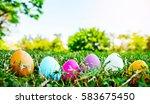 easter eggs in grass against... | Shutterstock . vector #583675450