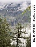 melting glacier descending from ... | Shutterstock . vector #583679188