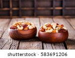 Nuts Mixed In A Wooden Plate...