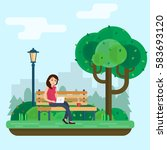young woman works in park with... | Shutterstock .eps vector #583693120