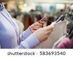 young woman hands choosing the... | Shutterstock . vector #583693540