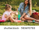 mother and daughter at a picnic ... | Shutterstock . vector #583693783