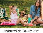 mother and daughter at a picnic ... | Shutterstock . vector #583693849