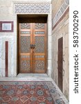 Small photo of Cairo, Egypt - February 18 2017: Ancient decorated door (arabesque) at Al Rifaii Mosque (aka Royal Mosque), located in al-Qal'a square, constructed between 1869 and 1912