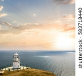 Lighthouse On A Marine Cape At...