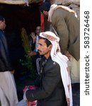 Small photo of SANAA,YEMEN - MARCH 14, 2010: Unidentified dealers of Khat (Catha Edulis) shown in Sanaa, capital of Yemen. Khat contains an amphetamine alkaloid stimulant narcotic illegal in most countries