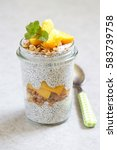 Small photo of Chia pudding with peach and mango slices in a jar