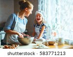 happy family in the kitchen.... | Shutterstock . vector #583771213