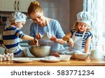 happy family in the kitchen.... | Shutterstock . vector #583771234
