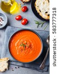 tomato soup in a black bowl on... | Shutterstock . vector #583777318