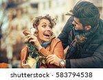 handsome man surprising his... | Shutterstock . vector #583794538