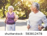 Small photo of Joyful aged woman going after her husband