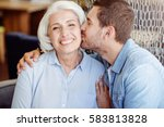 positive man kissing his... | Shutterstock . vector #583813828