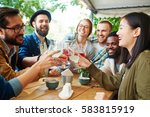 cheerful buddies toasting with... | Shutterstock . vector #583815919